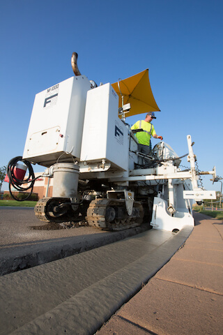 Concrete curbing installation with machine in Coon Rapids, MN