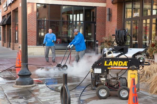 cleaning and sealing concrete at Calhoun Square in Minneapolis with hot water and big compressor